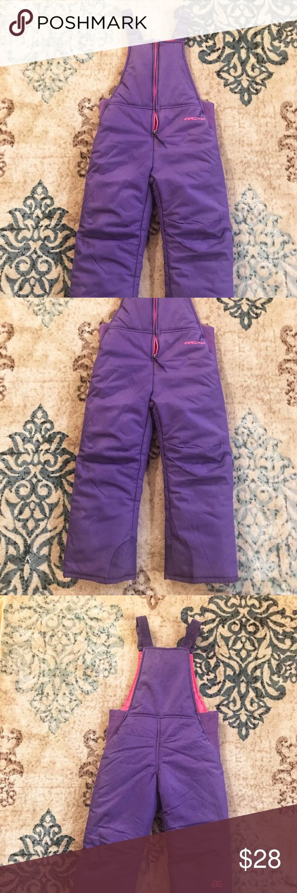 Arctix - Girls Purple Chest High Snow Bib Overalls Keep your little one warm in this purple chest high snow bib overalls from Arctix.  Adjustable comfort suspenders for the perfect fit!  Never worn as my daughter outgrew them by this winter! Arctix Jackets & Coats