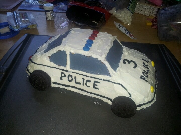 My police car cake, made for my son Lochlan's 3rd birthday!!! Used the Wilton 3D cake mold for the shape, then frosted and decorated it myself