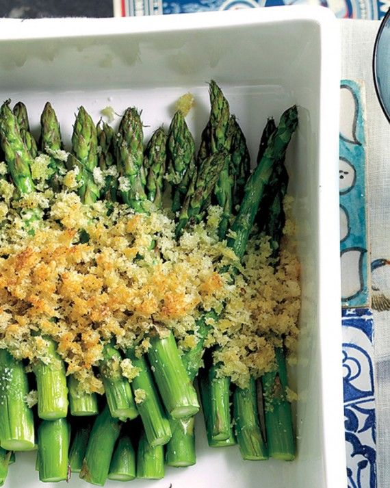 Homemade Parmesan breadcrumbs add a savory crunch to this asparagus side dish. No need to cook the asparagus or toast the breadcrumbs beforehand; simply arrange the asparagus in an ovenproof serving dish, sprinkle with fresh breadcrumbs, and bake everything at once.