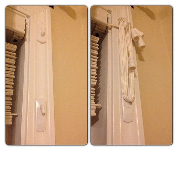 Blind cord management. Wrap the cord around two command hooks. Keeps the cords high and safely away from kids. Curtain hides the cord. Command hooks can come off without damaging your trim.