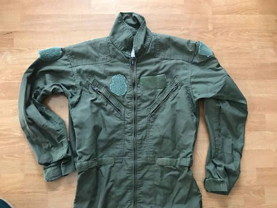 """Vintage military flyers coveralls. Velcro spots for patches. Zippered front. Measures approximately Shoulder seam to shoulder seam 21"""" Armpit to armpit 21"""" Length 64"""" Sleeve length 26"""" Inseam 31"""" Waist 38"""" Marked 40l, Flyers, type-1 Vintage condition- general signs of age and"""