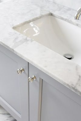 Cabinets painted in Benjamin Moore Pigeon Gray. Great bathroom cabinet color.  Counter is statuario marble.  Beautiful.