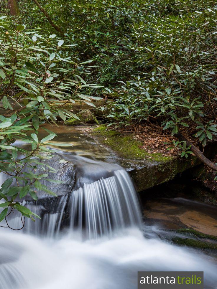 Hike a short, under-half-mile trail to stunning waterfalls at Georgia's Minnehaha Falls on the shore of Lake Rabun