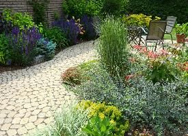 Bursts of colour throughout all of the seasons. Gardens and cobblestone walkway installed by the team at Pathways to Perennials. www.pathwaystoperennials.com