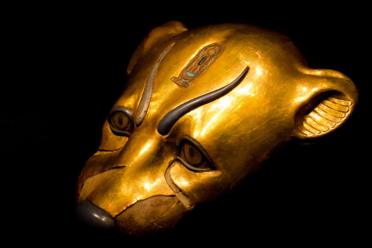 A gold gilded object is the shape of a leopard found within the intact KV62 tomb of king Tutankhamun. It bears the boy king's cartouche atop its head.