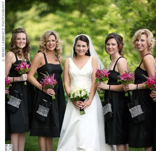I love a basic black dress for bride's maids. It elegant, versatile, and everyone looks good in black.