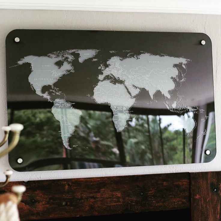Laser cut and engraved perspex world map. Three layers mounted to the wall.