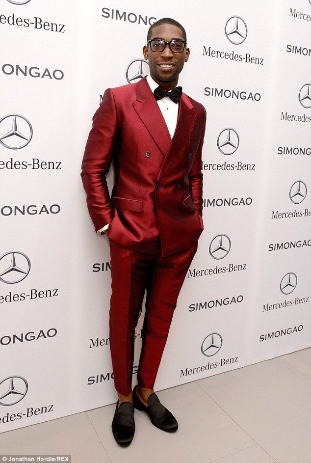 Looking good: Tinie Tempah looked sharp in a deep red suit and a black dickie bow tie