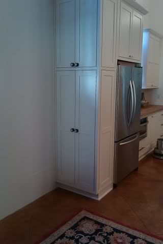 """Still working on our kitchen layout, but at the moment, our plan for the new 36"""" standard depth french door refrigerator is at the end of a cabinet run, with the side open to the breakfast nook. The KD put cabinets over the refrigerator and a surrounding panel for the fridge, so it is boxed in...."""