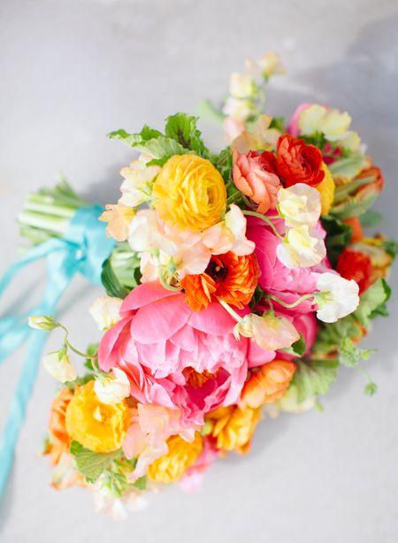 Spring bouquet: peonies, ranunculus, tulips, sweet peas