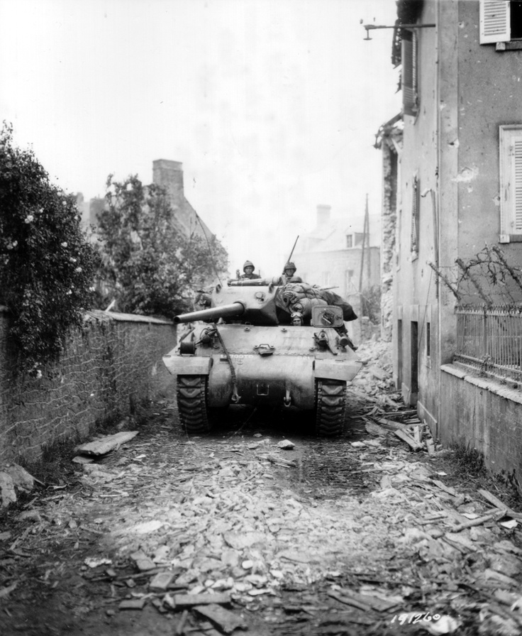 A US 3rd Armored Division M10 tank destroyer negotiates a narrow alley in St Fromon, France on July 7, 1944. St Fromon was liberated on the same day by the 117th Regiment of the 30th Infantry Division.