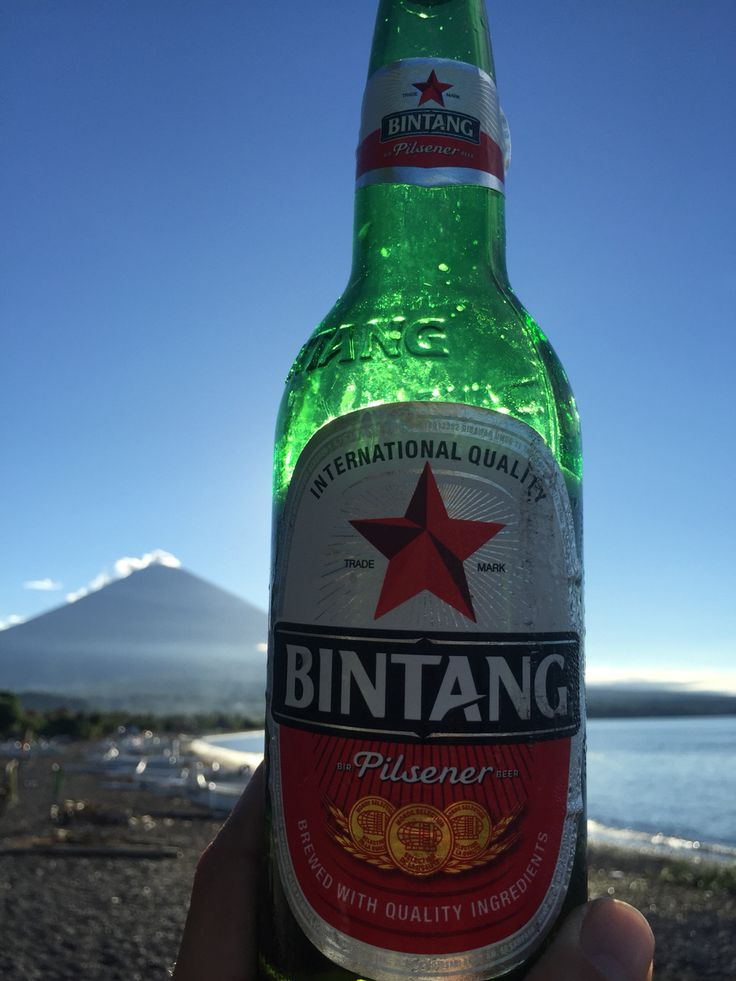 Drinking Bintang on the beach in Ahmed, while looking at Mt Agung
