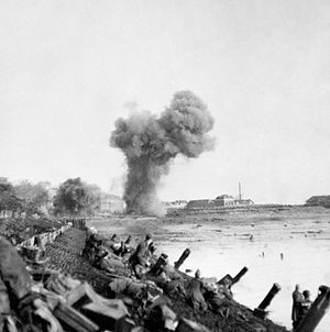 British assault troops on Walcheren advancing along the waterfront near Flushing with shells bursting ahead - 1 November 1944.Operation Infatuate was the code name given to an Anglo-Canadian operation during the Second World War to open the port of Antwerp to shipping and relieve logistical constraints. The operation was part of the wider Battle of the Scheldt and involved two assault landings from the sea by the 4th Special Service Brigade and the 52nd (Lowland) Division.