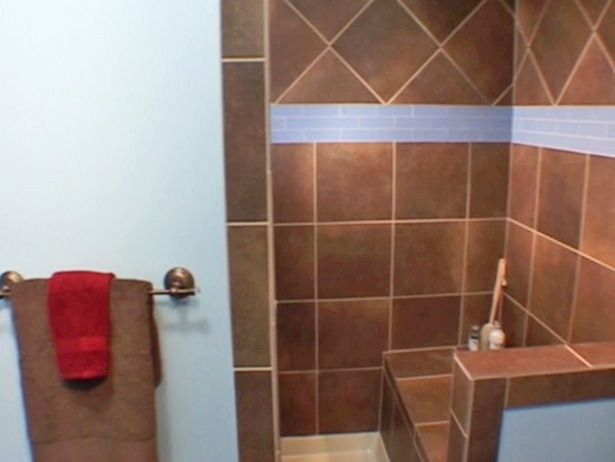 How to Tile a Shower  DIY expert Amy Matthews shows how to tile shower walls like a pro