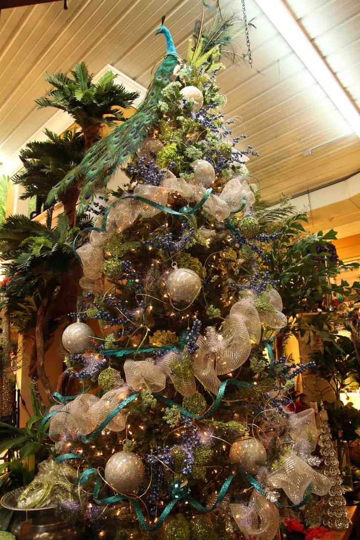 Germanic paganism amazing tabletop christmas trees decorating plan - Beautiful Christmas Tree In Teals Greens Creams Platinum With Peacock Tree Topper Evergreen
