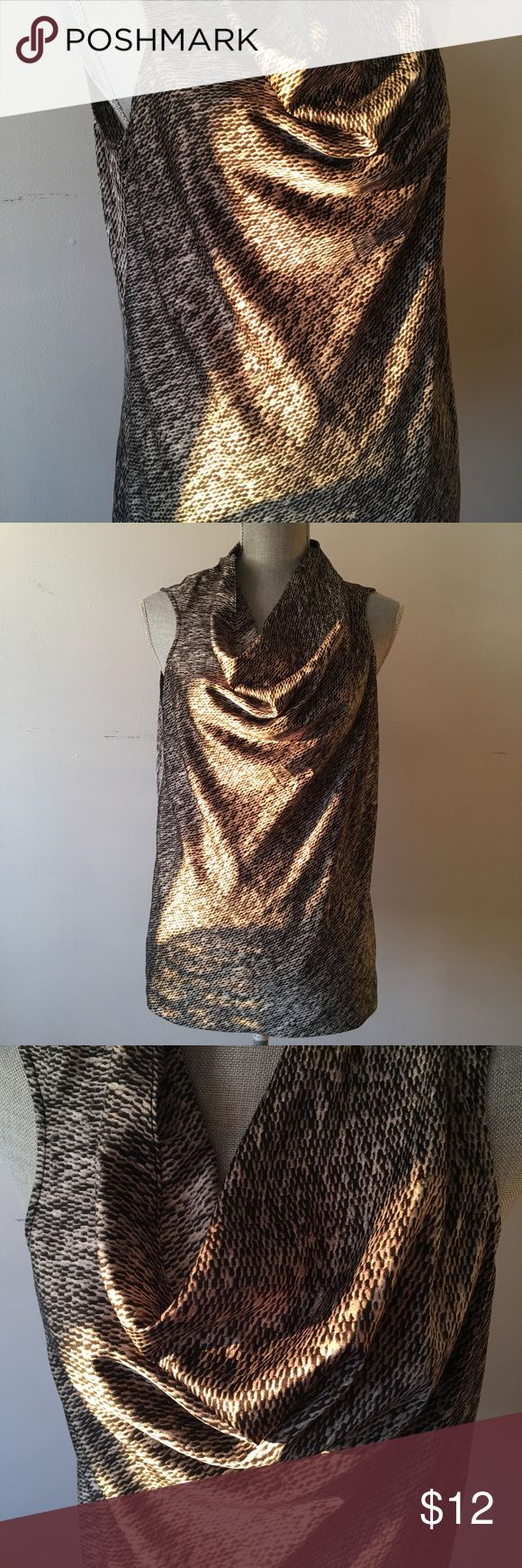 Vince Camuto snake print top Such an elegant top for a night out or for office dress code if worn under a classic blazer ! Great condition and very flattering to your figure . Vince Camuto Tops Blouses
