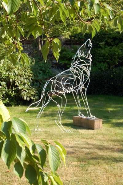 Galvanised welded steel Dog sculpture by artist Amy Goodman titled: Howling Wolf