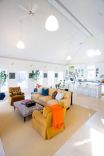 Bright orange throw; peach couch