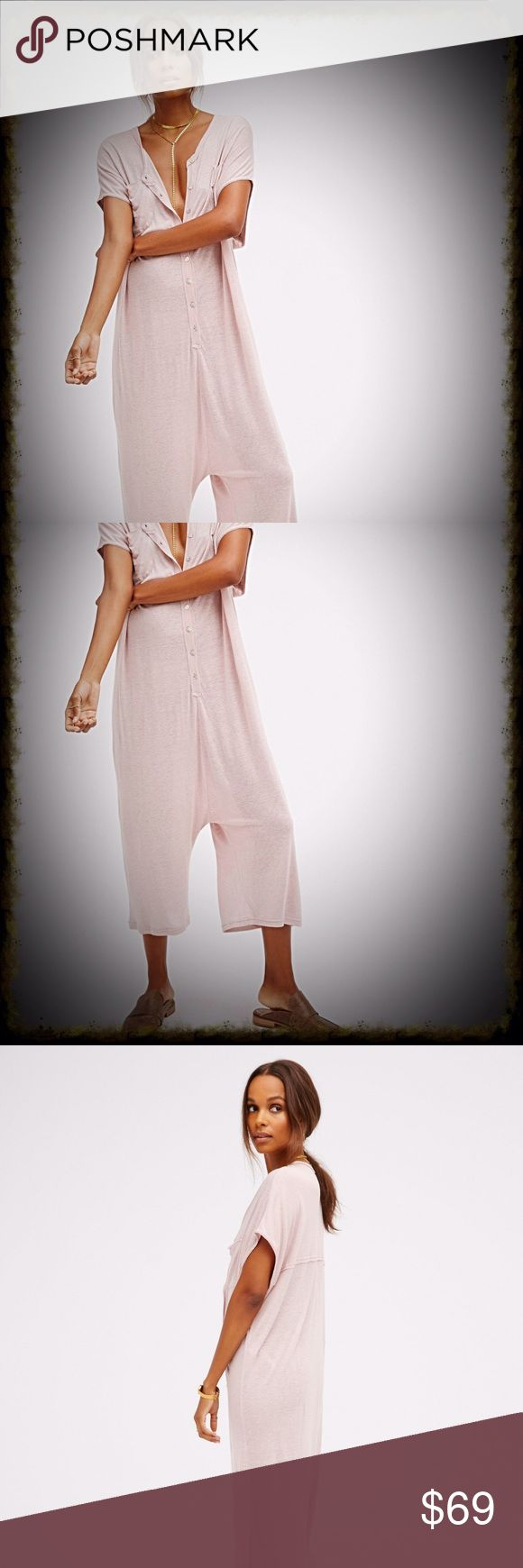 Free People Morocco Rompet Oh-so-soft and cozy oversized romper with a cropped leg. Features exposed button closures along the front and a cute two-pocket detail. Semi-sheer fabrication. Throw on as a cover-up over your favorite swimwear or over one of our seamless rompers for an easy effortless look.   *By FP Beach *70% Rayon *30% Linen *Genuine Shell Buttons *Hand Wash Cold *Import.   Color. Soft blush nude color. * worn once. In excellent just like new cond  oversized Slouchy fit…