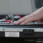 Disc jockeys play an integral role in orchestrating the events of a wedding  reception. From announcing the arrival of the new couple to gathering  guests for  the  cake cutting, the DJ can help ensure that the festivities run  smoothly. The DJ also plays an entertainer role by providing games as well as music.