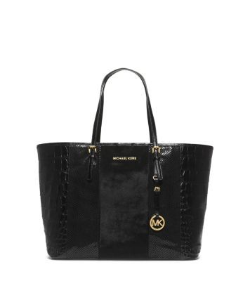 MK Get a handle on a tried-and-true favorite—our Jet Set tote will stay in your handbag rotation forever. Updated in an opulent blend of hair calf and embossed leather, this sharp carryall is stylish enough to complement your chicest evening looks. Transitioning your look from day to night has never been this easy.