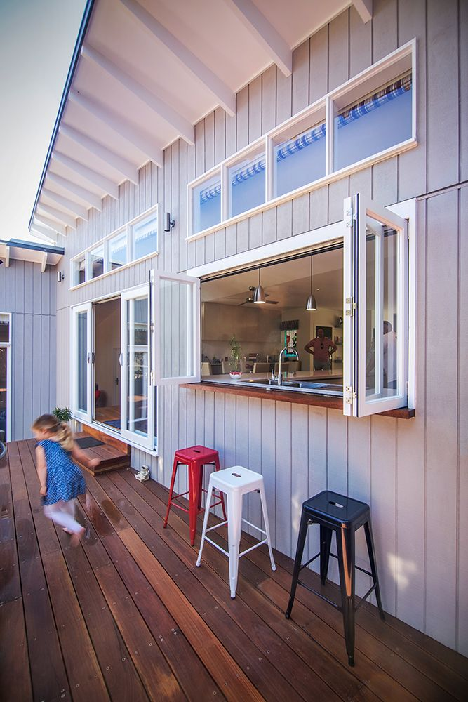 Beach-side alterations and addition of weatherboard home by Sketch Building Design. Kitchen servery window to outdoor breakfast bar.