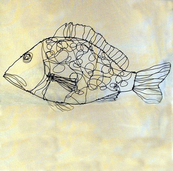 This Dotty Fish is on sale-was $68. This is a wound wire (dark annealed steel wire) sculpture-of a fish covered with dots. You can hang it on the wall with a little loop on its back. Its approximately 12 long. Signed with an SG wound into the wire-for Susan Graham. The image of