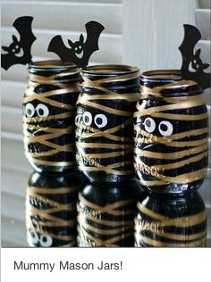Love it! For this craft, paint mason jars with black spray paint. Glue on googly eyes, and wrap strips of metallic gold washi tape around the jar to create the mummy.