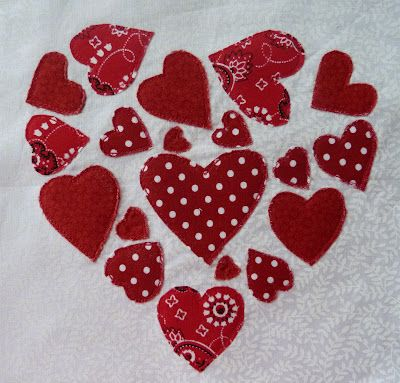 raw edge appliqued the hearts onto the background and for good measure added a layer of batting to the back. After the applique was done I then very carefully cut the excess batting away, which results in a sort of Trapunto effect
