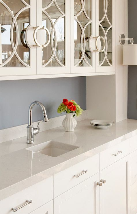 "White butler's pantry, silestone ""lagoon"" counters, glass front detail"