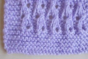 Lilac Blossom Baby Blanket - The Lilac Blossom Baby Blanket is the perfect way to keep your little one nice and cozy. This lace knitting pattern is super easy to make, meaning you can work on it anywhere and knit it up quickly. Learning how to make a blanket has never been easier, especially since it is so tiny. This gorgeous baby blanket pattern is light and airy, making it great for cooler summer evenings.