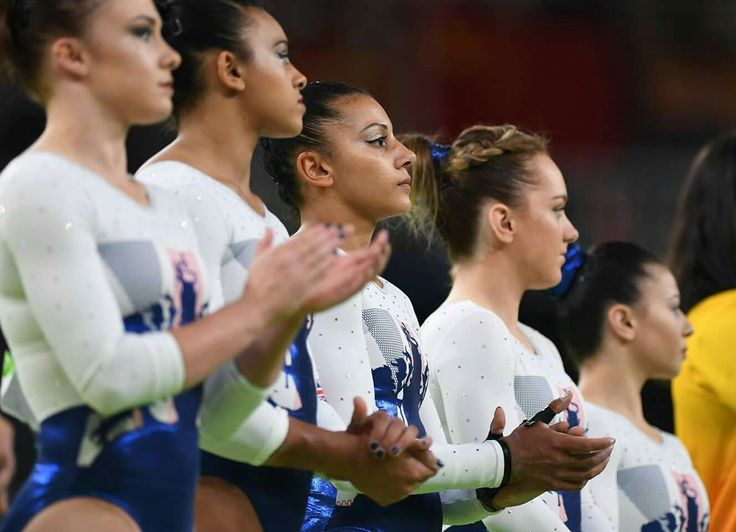 RIO DE JANEIRO, BRAZIL - AUGUST 09: Rebecca Downie (C) and members of Great Britain are introduced before the Artistic Gymnastics Women's Team Final on Day 4 of the Rio 2016 Olympic Games at the Rio Olympic Arena on August 9, 2016 in Rio de Janeiro, Brazil. (Photo by Laurence Griffiths/Getty Images)