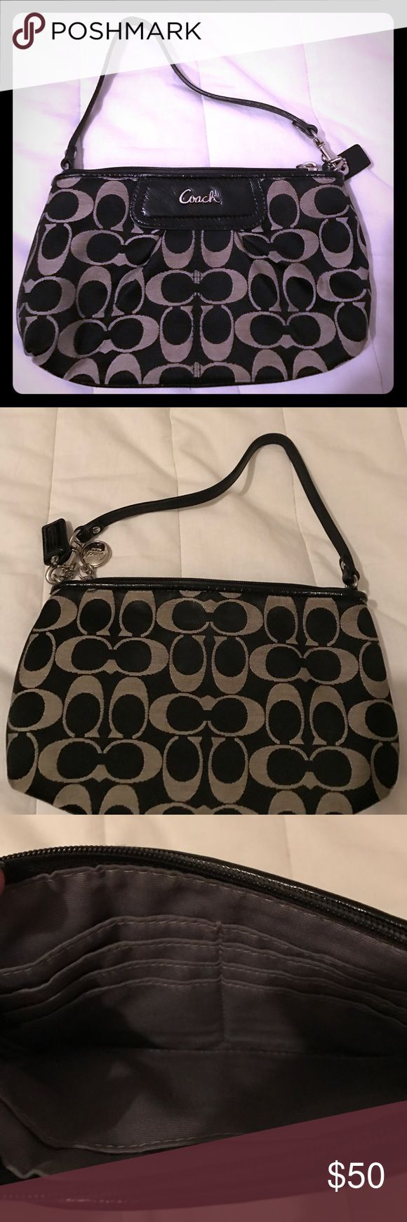 Coach clutch purse Black and silver/white designer Coach clutch purse. Only used a few times. Bought something smaller so need to sell. Great condition. Authentic. Coach Bags Clutches & Wristlets