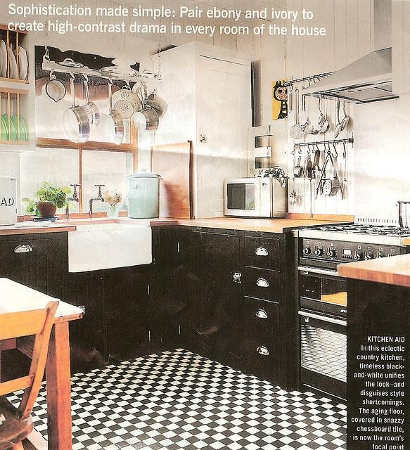 black lower cabinets butcher block countertops white