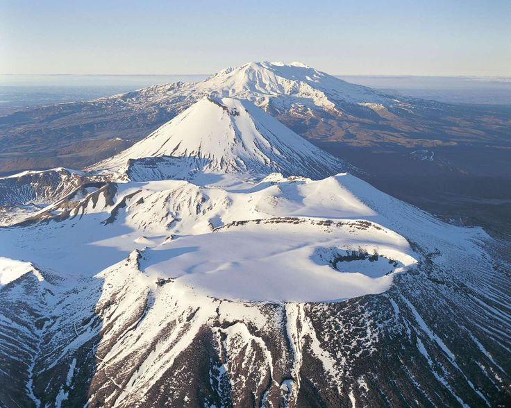 Mount Tongariro, Mount Ngauruhoe, and Mount Ruapehu in New Zealand's Tongariro National Park.Volcani... - Photo: Rob Brown/Getty Images