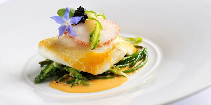 Beautiful brill fillets are paired with a rich lobster sauce in this luxurious seafood dish from Simon Hulstone