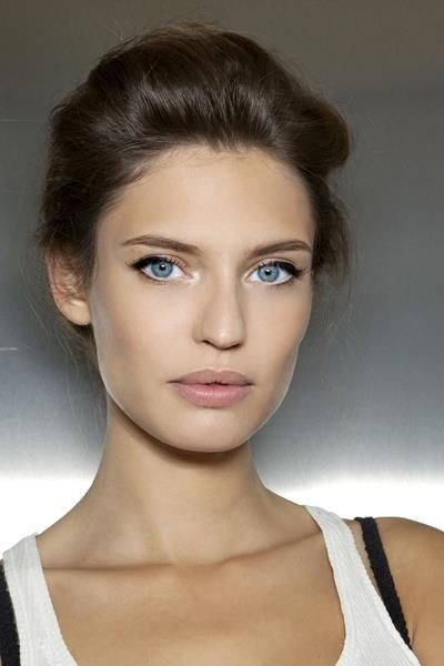Simple pretty makeup in soft natural colors and elegant up-do.