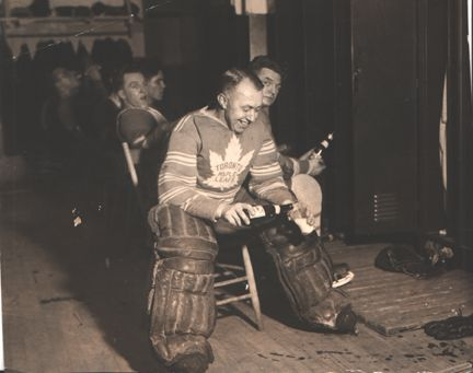 Goalies before 1950: George Hainsworth, pouring a beer after a win
