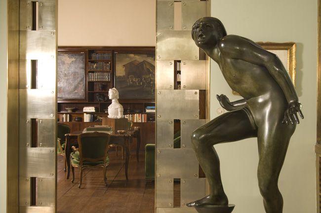 Villa Necchi Campiglio - View of the veranda towards the library  In the foreground:   Adolf Wildt, The Pure Lunatic,  1930, bronze