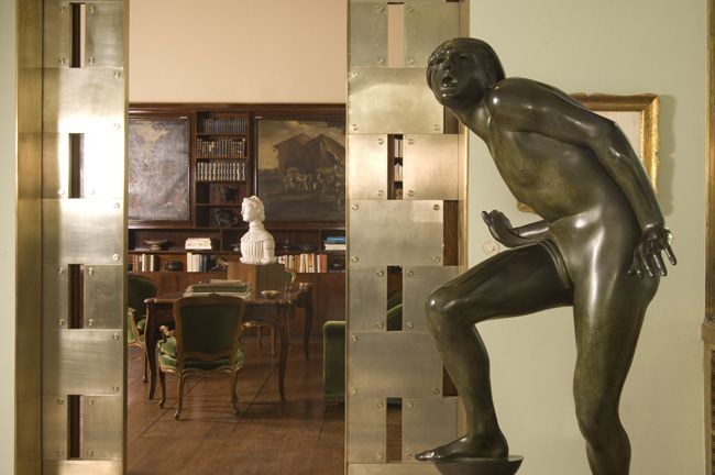 Villa Necchi Campiglio - View of the veranda towards the library  In the foreground:   Adolf Wildt, The Pure Lunatic,  1930, bronze