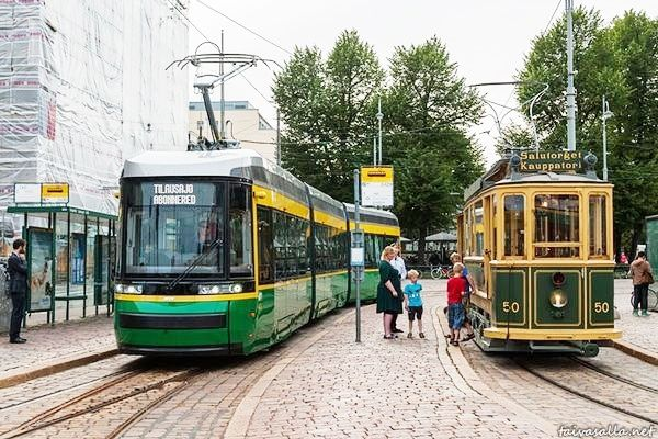 Helsinki, Finland: The newest and the oldest tram in the city met at the Market Square. The tram on the left was built this year (2013), while the vintage tram on the right is from 1909.