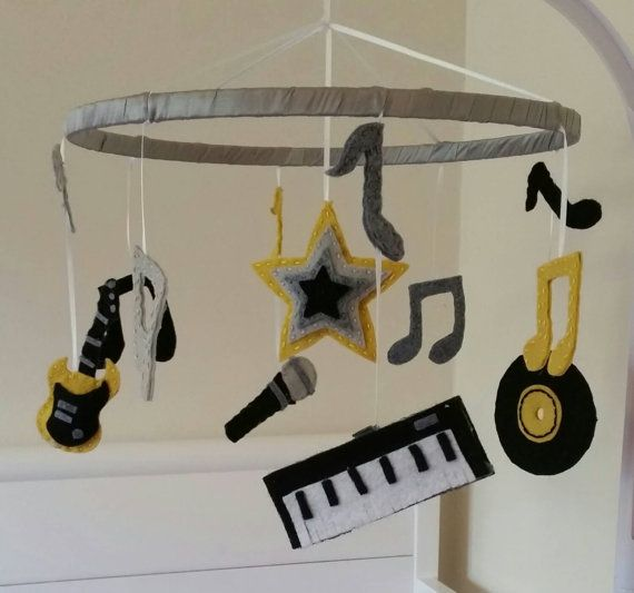 This cool rock and roll themed mobile will have your little one rocking themselves to sleep on a nightly basis!   The mobile features an electric