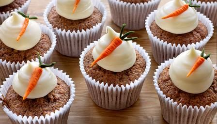 Dan Lepard's rich carrot cupcakes topped with cream cheese frosting