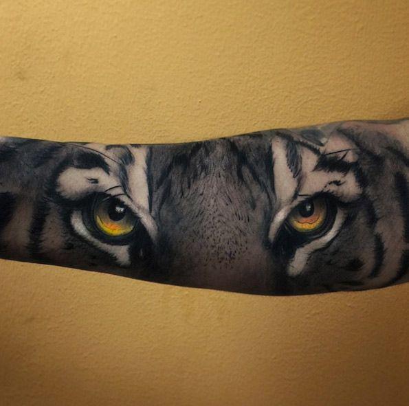 Tiger eyes tattoo by Alex Bruz