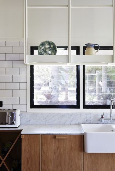 Owen and Vokes and Peters // Panorama Drive House // white; timber; marble; subway tiles; custom drying rack; wine bottle storage; butler sink