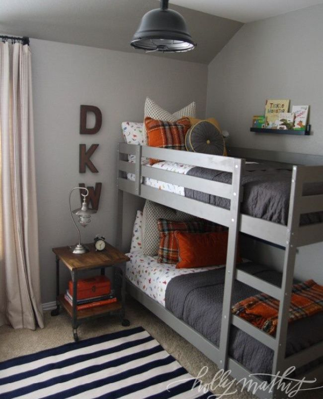 Loooove this gray paint colour (Sherwin Williams) in this boys bedroom.  The room look restful and a bit rustic industrial with the gray on gray with a splash of orange! #BoysBedroom #KidsDecoratingIdeas #KidsBedrooms