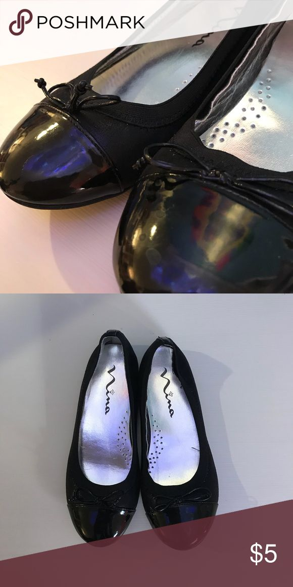 Nina Kids Black Patent Leather Ballet Flat - textile upper features featuring a synthetic leather patent toe cap and a little bow on top - slip on design with elastic for easy comfortable fit - textile lining - lightly cushioned footbed - worn once Nina Shoes Shoes