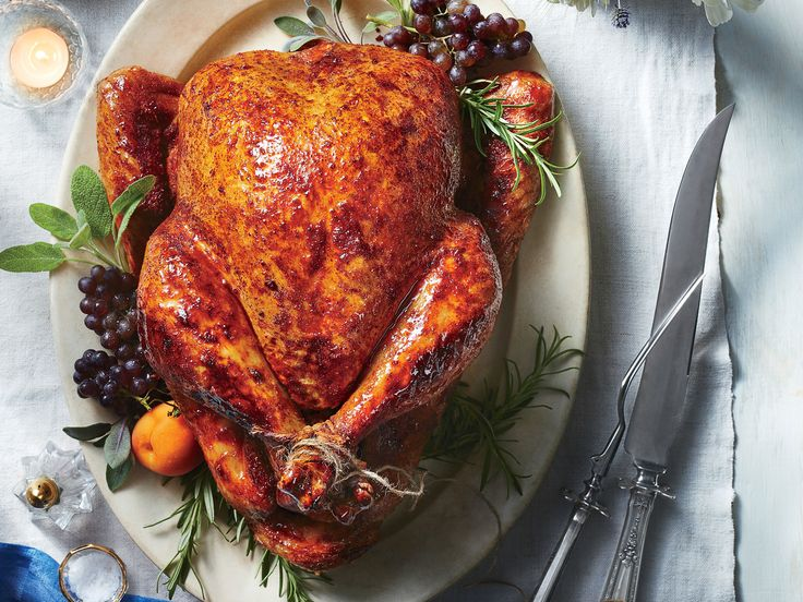 Sweet-and-Spicy Roast Turkey Recipe | Go bold with a turkey that's packaged with heat—and a touch of sweetness. We dry-brined this brid with a fragrant spice rub and then roasted it with a honey-hot sauce glaze. This recipe might be a surprising new addition to your holiday table, but we think it will earn a repeat invitation.