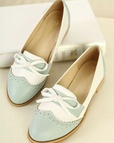 Sweet British Style Perforated Bowknot Flats . These would be so cute with distressed boyfriend jeans and a white t.