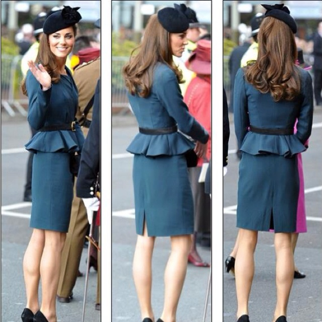 Kate in a LK Bennett peplum-style dress and coat earlier this morning.  ©Alan Davidson/The Picture Library